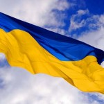 Ukraine-flag-waving-in-the-air-612x336